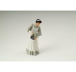 Dienstmeisje aan het strijken