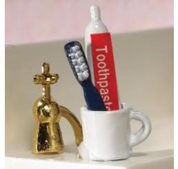 Tandenborsten, tandpasta en mok