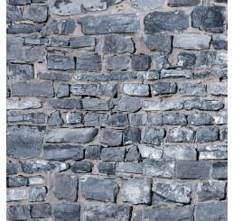 Grijze muurstenen met relief