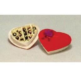 Chocolaatjes in hartvormige doos